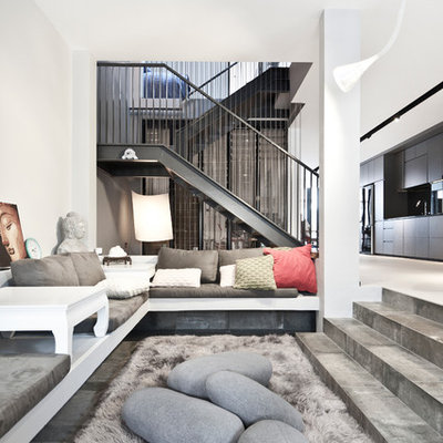 Living room - contemporary formal and open concept concrete floor living room idea in Singapore with white walls
