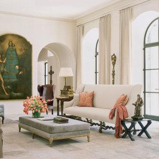 ヒューストンの広い地中海スタイルのおしゃれな独立型リビング (フォーマル、白い壁、ライムストーンの床、標準型暖炉、石材の暖炉まわり、テレビなし、マルチカラーの床) の写真