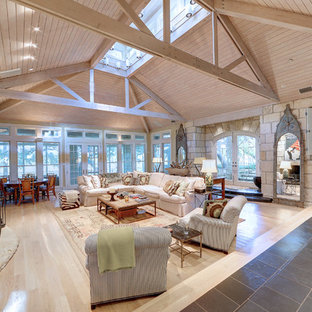 Inspiration for a farmhouse formal and open concept light wood floor living room remodel in Austin