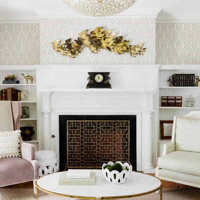 Mid-sized elegant formal and open concept medium tone wood floor and brown floor living room photo in Boston with multicolored walls, a standard fireplace, a plaster fireplace and no tv