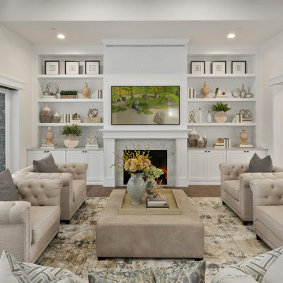 Large transitional open concept medium tone wood floor and brown floor living room photo in Seattle with white walls, a wall-mounted tv, a standard fireplace and a tile fireplace