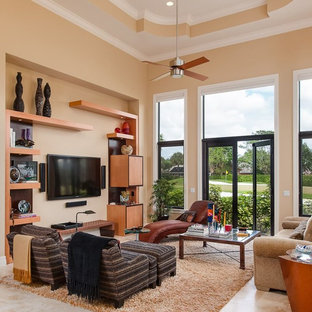 Trendy beige floor living room photo in Miami with beige walls and a wall-mounted tv
