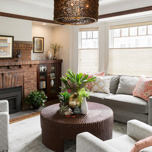 Large transitional formal enclosed living room in San Francisco with grey walls, dark hardwood floors, a standard fireplace, a brick fireplace surround and no tv.