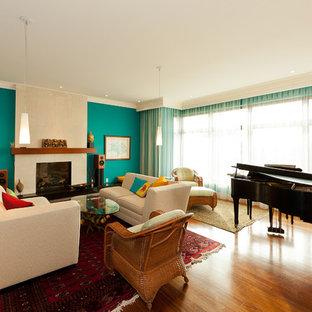 Inspiration for a contemporary living room remodel in Edmonton with a music area and a standard fireplace