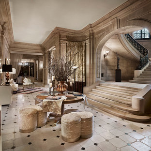 Living room - huge traditional formal and enclosed marble floor living room idea in New York with beige walls