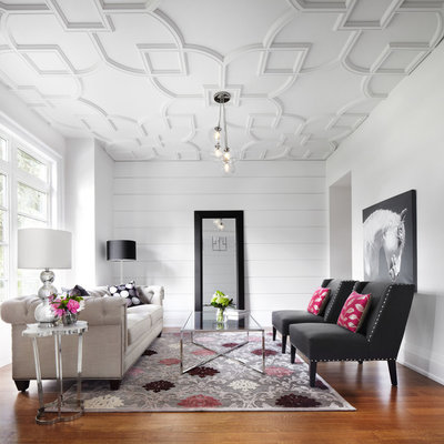 Inspiration for a contemporary brown floor living room remodel in Toronto with white walls
