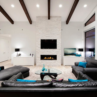 Inspiration for a contemporary living room remodel in Vancouver with white walls, a ribbon fireplace and a wall-mounted tv
