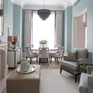 Inspiration for a transitional light wood floor living room remodel in London with blue walls and a standard fireplace
