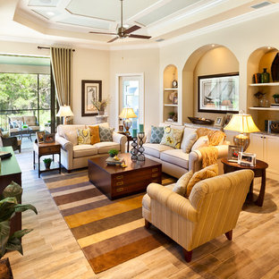 Inspiration for a large timeless open concept porcelain floor living room remodel in Tampa with beige walls, no fireplace and a wall-mounted tv