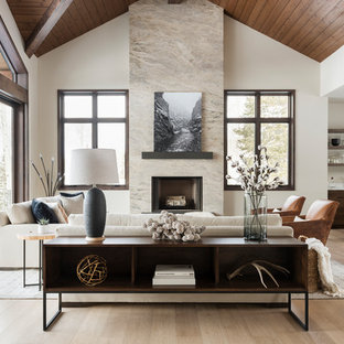 Inspiration for a large contemporary open concept medium tone wood floor and beige floor living room remodel in Salt Lake City with a bar, beige walls, a standard fireplace, a stone fireplace and no tv