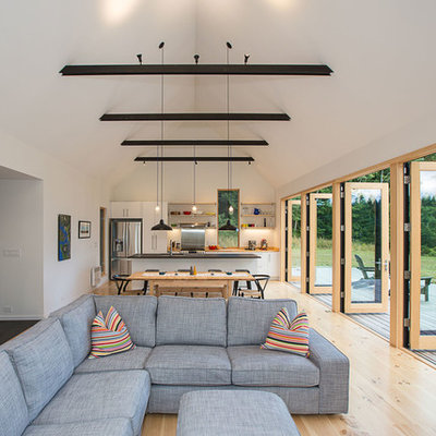 Inspiration for a small rustic open concept light wood floor living room remodel in Seattle with white walls