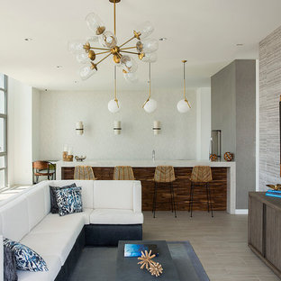 Example of a trendy open concept living room design in New York with gray walls and a wall-mounted tv