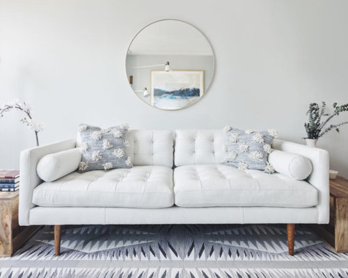 Example Of A Coastal Living Room Design In New York With White Walls