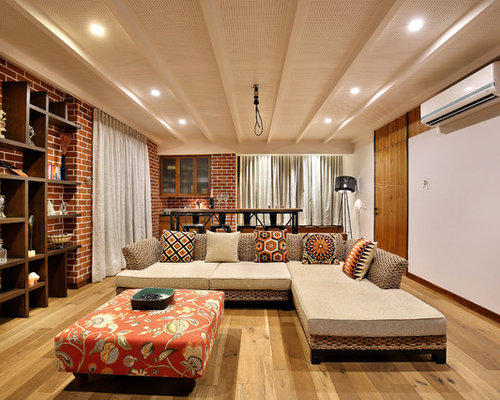 Mid Sized Open Concept Medium Tone Wood Floor Living Room Photo In Ahmedabad