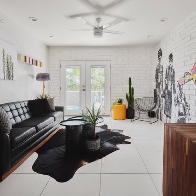 Living room - mid-sized contemporary formal and enclosed white floor and brick wall living room idea in Phoenix with white walls and no tv