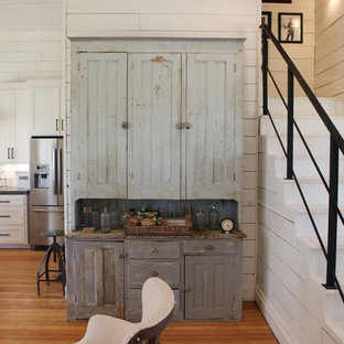 Example of a mid-sized farmhouse open concept medium tone wood floor living room design in Austin with white walls, no fireplace and no tv