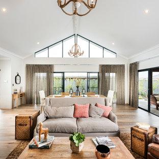 Idée de décoration pour un grand salon tradition ouvert avec un mur gris et un sol en vinyl.