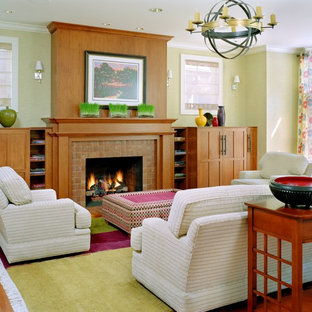 Trendy living room photo in St Louis with green walls, a standard fireplace and a tile fireplace