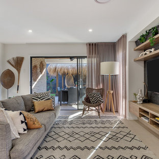 Inspiration for a contemporary open concept living room in Brisbane with white walls, a wall-mounted tv and beige floor.