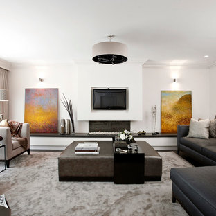 Photo of an expansive contemporary living room in London with a ribbon fireplace.