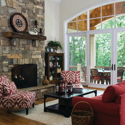 Living room - large traditional open concept medium tone wood floor living room idea in Charlotte with beige walls, a standard fireplace, a stone fireplace and no tv