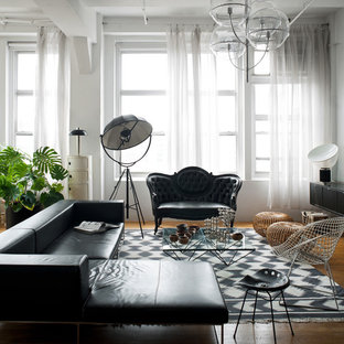 Inspiration for a victorian enclosed medium tone wood floor living room remodel in New York with white walls