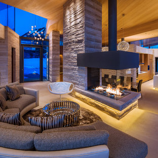 Large trendy open concept living room photo in Denver with a two-sided fireplace, no tv and beige walls