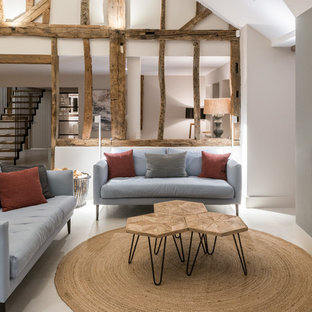 Design ideas for a large rural open plan living room in Other with white walls, limestone flooring, a two-sided fireplace, a metal fireplace surround and white floors.