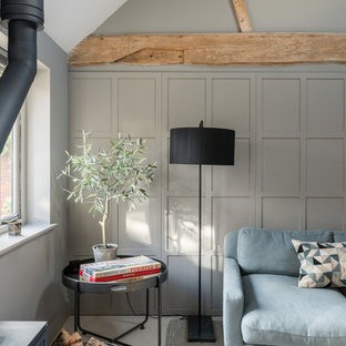 Inspiration for a large rural enclosed living room in Other with grey walls and a wood burning stove.