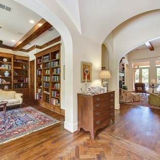 Example of a mid-sized classic medium tone wood floor living room design in Dallas with white walls