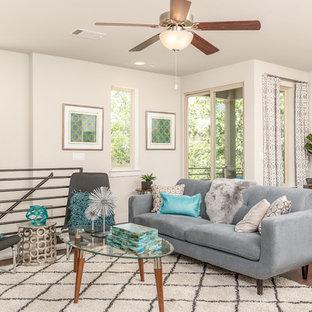 Living room - contemporary loft-style medium tone wood floor living room idea in Austin with gray walls