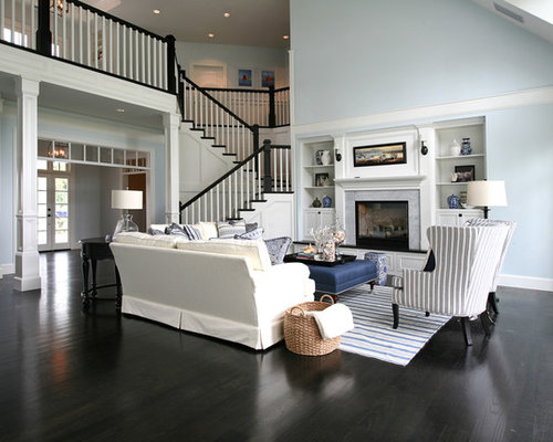 Example Of An Ornate Black Floor Living Room Design In Portland With Blue  Walls Part 57