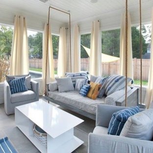 Example of a beach style living room design in Charleston