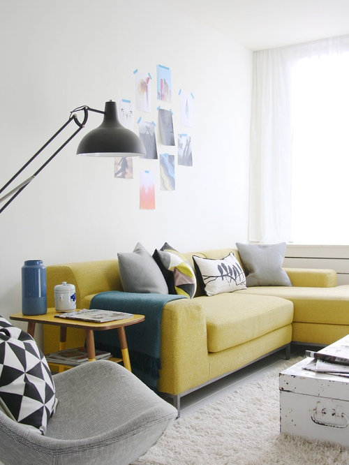 Example Of A Mid Sized Danish Living Room Design In Amsterdam With White Walls