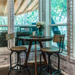 ダラスのカントリー風おしゃれなリビング (グレーの壁、濃色無垢フローリング、標準型暖炉、木材の暖炉まわり、壁掛け型テレビ) の写真