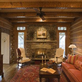 Diseño de salón para visitas cerrado, rústico, de tamaño medio, sin televisor, con paredes marrones, chimenea tradicional y marco de chimenea de piedra