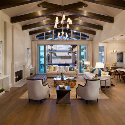 Huge transitional formal and open concept medium tone wood floor and brown floor living room photo in Tampa with beige walls, a standard fireplace and a stone fireplace