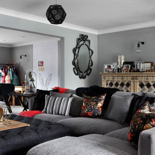 Design ideas for an expansive traditional open plan living room in London with grey walls, carpet and a wall mounted tv.