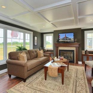 トロントの大きいトランジショナルスタイルのおしゃれなLDK (グレーの壁、無垢フローリング、標準型暖炉、タイルの暖炉まわり、壁掛け型テレビ、茶色い床) の写真