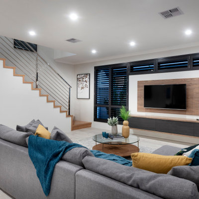 Inspiration for a large contemporary carpeted and gray floor living room remodel in Perth with white walls and a wall-mounted tv