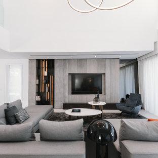 Ejemplo de salón abierto, contemporáneo, con paredes blancas, televisor colgado en la pared y suelo gris