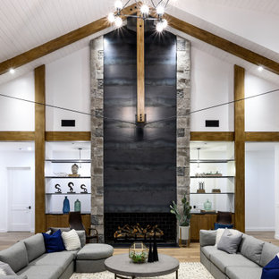 Living room - large farmhouse open concept medium tone wood floor and brown floor living room idea in Phoenix with white walls, a standard fireplace and a metal fireplace