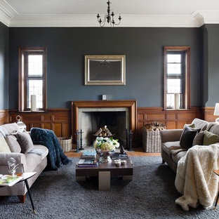 Inspiration for a traditional formal living room in Surrey with grey walls, medium hardwood flooring, a standard fireplace and no tv.