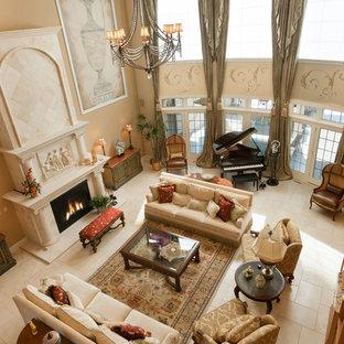 ミルウォーキーの地中海スタイルのおしゃれなリビングロフト (フォーマル、ベージュの壁、セラミックタイルの床、標準型暖炉、石材の暖炉まわり、テレビなし) の写真