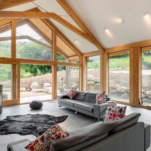 Rustic formal open plan living room in Devon with slate flooring.