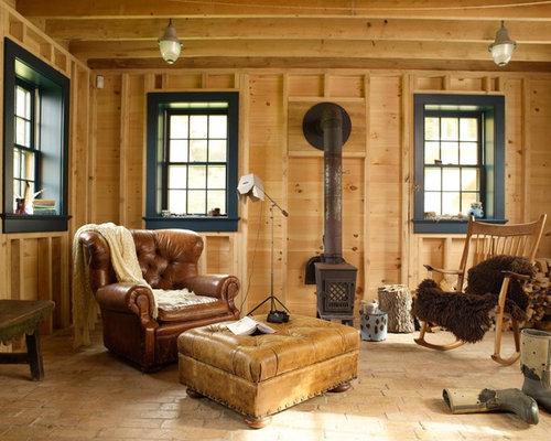 Salon avec un poêle à bois et un sol en brique : Photos et idées ...