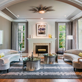 Living room - mid-sized contemporary enclosed and formal dark wood floor and brown floor living room idea in Philadelphia with gray walls, a standard fireplace, a stone fireplace and no tv