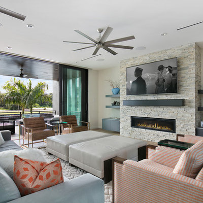 Living room - mid-sized contemporary open concept porcelain tile and brown floor living room idea in Tampa with a ribbon fireplace, a stone fireplace, a wall-mounted tv and gray walls