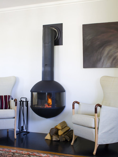 Coastal Living Room Photo In Boston With A Wood Stove