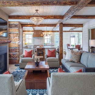 Example Of A Mountain Style Formal And Open Concept Medium Tone Wood Floor  And Brown Floor